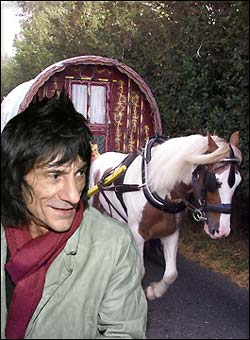 Ronnie Wood in front of Gypsy Caravan