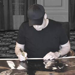 John Travolta, signing painting by Stephen Holland