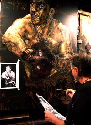 Stephen Holland painting Rocky Marciano in his Studio