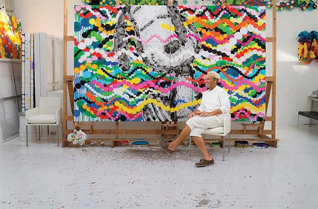 Tom Everhart in studio in front of Big Poppa painting